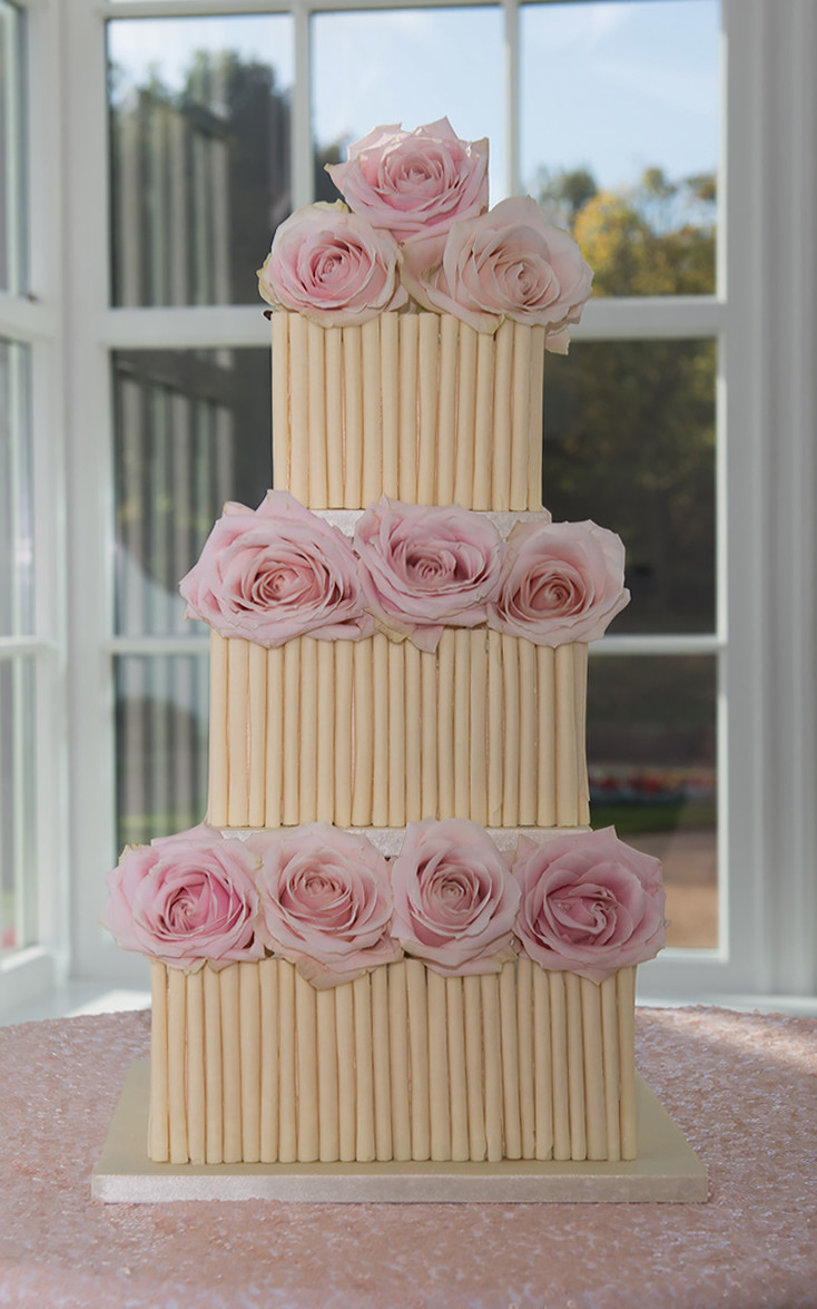 St helens avalanche rose cigerello white chocolate wedding cake