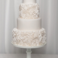 modern-white-ruffle-rosette-wedding-cake
