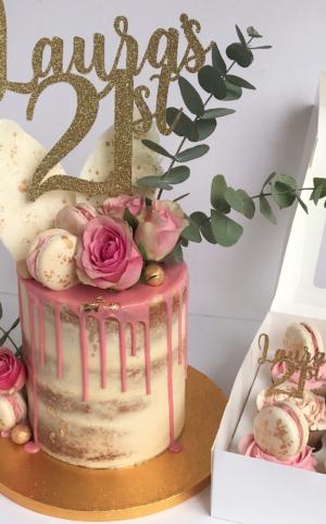 pink birthday cake, gold 21st topper