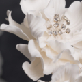 modern white ruffle wedding cake bling close up 2