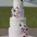 pink white ruffle anemone and dusty miller wedding cake