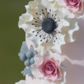 pink white ruffle anemone and dusty miller wedding cake close up 1