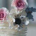 pink white ruffle anemone and dusty miller wedding cake close up 2
