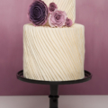 purple rose ranunculus pleated wedding cake
