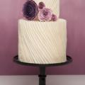 purple rose ranunculus pleated wedding cake