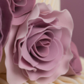 purple rose ranunculus pleated wedding cake close up 2