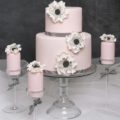 Pink black and white anemone wedding cake
