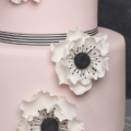 Pink black and white anemone wedding cake close up 2